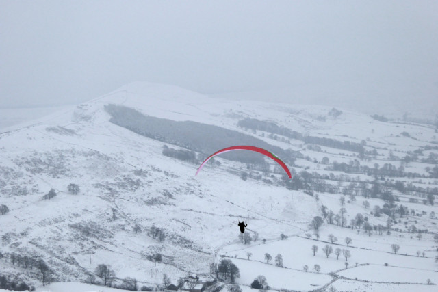 Paraglider setting off from Mam Tor in the Peak District