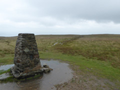 Trig point on Loadpot Hill, surrounded by water