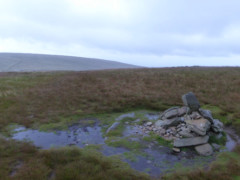 Cairn surrounded by water on Wether Hill