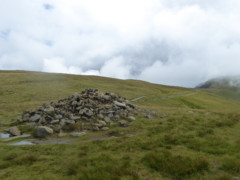 Large cairn at the summit of the Knott
