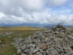 Large rocky summit cairn on the top of High Raise