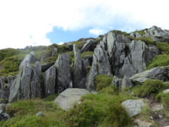 Large, pointed rocks on the side of the path up St Sunday Crag