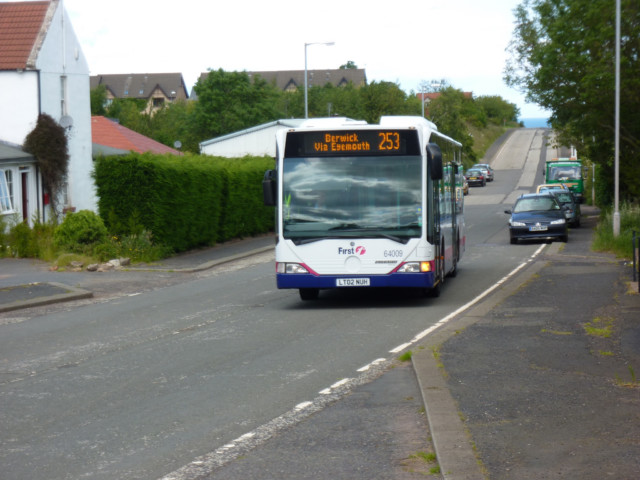 A bus to Berwick-upon-Tweed arrives at a bus stop in Cockburnspath