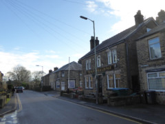 Houses and a pub in Chinley