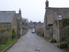 Houses lining a road on the edge of Hathersage