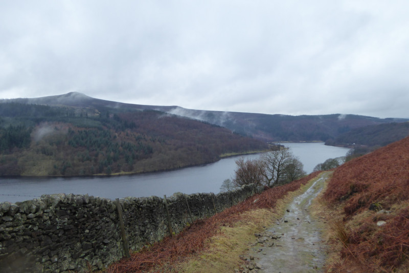 Part of Ladybower reservoir, surrounded by hills and heather moorland