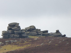 Gritstone rock formation known as the Wheel Stones, or Coach and Horses