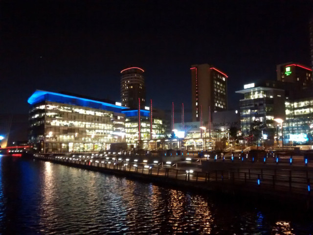 MediaCity's offices, photographed at night from across the quay