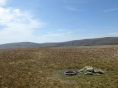 Branstree's summit with a small cairn and a circular trig point