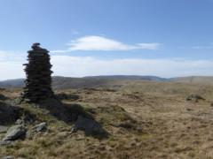 Tall and narrow cairn on Harrop Pike