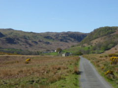 Road to Swindale, surrounded by hills and gorse bushes