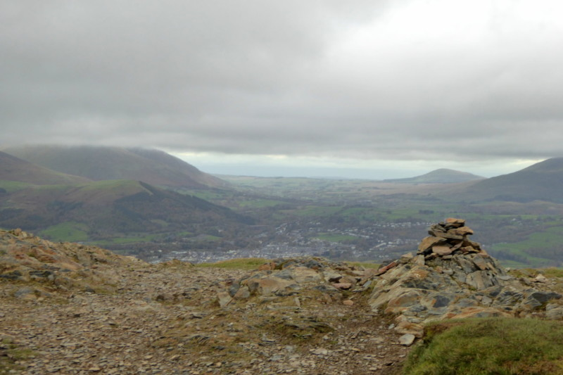 Barrow's summit cairn, with Keswick behind