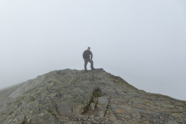 Standing on the rocky summit of Grisedale Pike