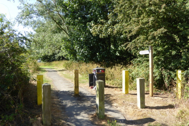 The start of the Wolds Way, with a signpost and a litter bin