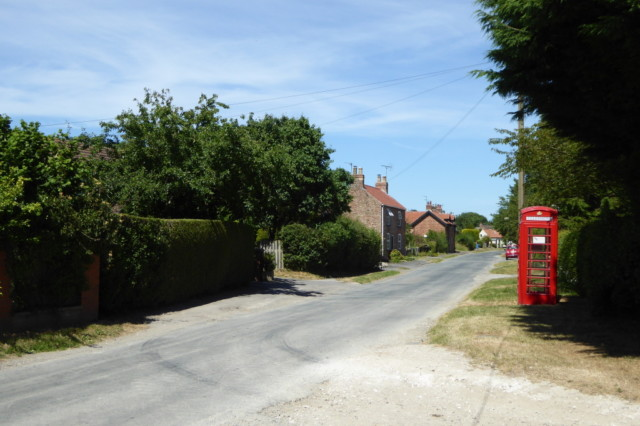 The main road through Nunburnholme, and it's red phone box
