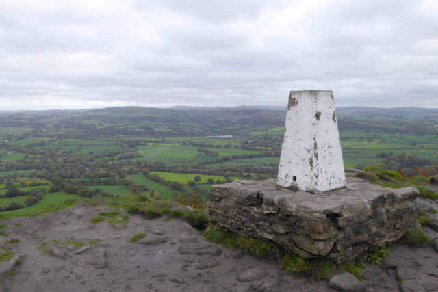 A white painted trigpoint on a hill called The Cloud