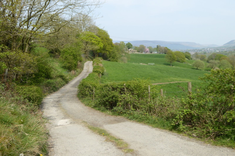 A car wide track leaving the village of Broadbottom