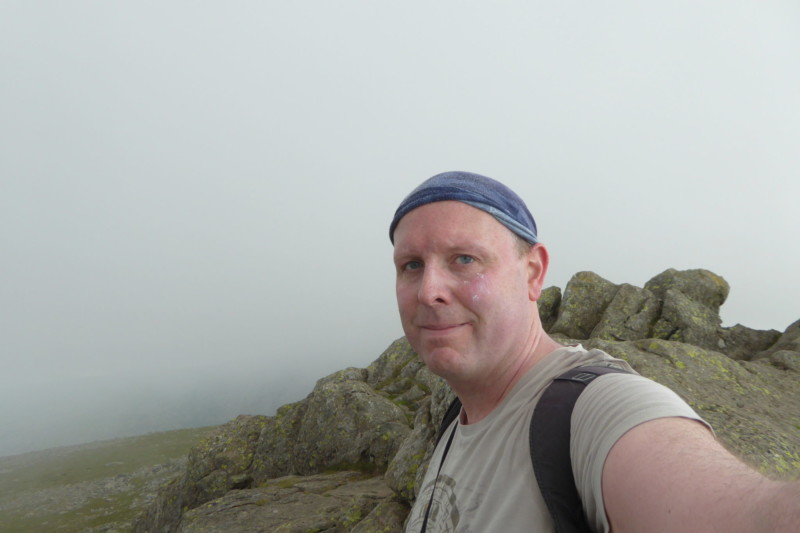 The author on top of Dow Crag in the cloud.