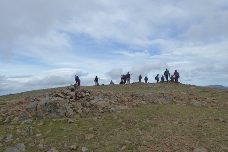 A large group of people at the summit of Red Pike