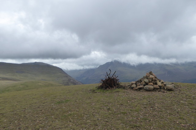 Cairn and a twisted pile of metal at the summit of Starling Dodd