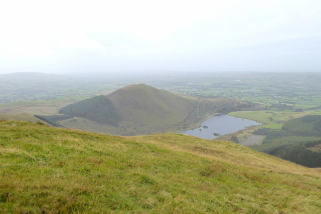 View of a hill and a lake, outside the Lake District