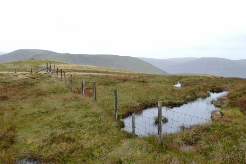 A fence and a pool of water on Gavel Fell