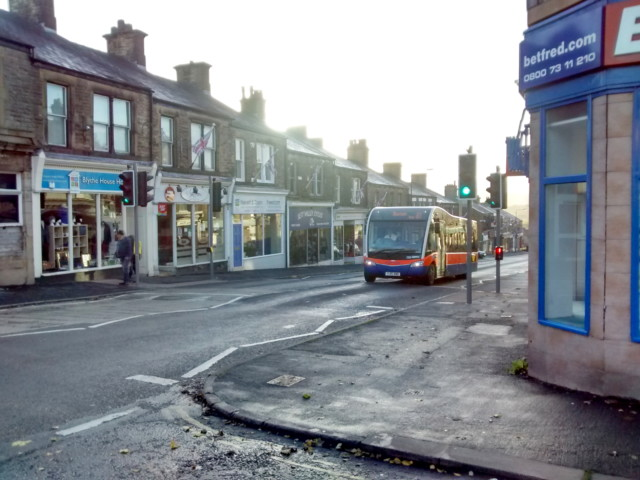 A bus from High Peak buses drives down New Mills's main street